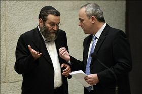 Finance Minister, Yuval Steinitz of Likud in a  conversation with chairman of the Knesset's Financial Committee, Moshe Gafni of Degel Hatorah during voting on the Arrangements Law.15.07.2009. Photo: Abir Sultan, Flash 90