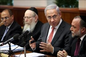 Prime Minister Benjamin Netanyahu at the weekly cabinet meeting. To his right, Deputy Finance Minister Yitzhak Cohen from Shas. His left hand, Deputy Health Minister Yaakov Litzman from United Torah Judaism, 28.08.2011. Photograph by: Flash 90.