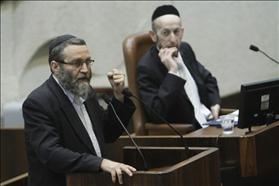 Chairman of the finance committee, Moshe Gafni from Degel Ha'tora, raising his fist during a speech at the Knesset assembly. To his right his party member Uri Maklev.07.05.2012. Photographed by: Miriam Elster, Flash 90.
