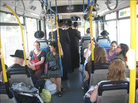 Women's organizations activists sitting in the front of  the segregated buses. 30.09.2009. Photography: Shiran Dadon