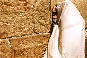 A Jew praying at the Western Wall; source: Wikipedia