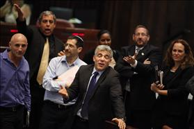 The Minister of Finance Yair Lapid at the Knesset gathering where the State's budget was approved in the second and third reading, for the years 2013 - 2014 (b). 29-07-2013. Photo: Flash 90