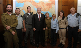 Prime Minister, Benjamin Netanyahu meets with soldiers  in his office before the IDF conversion. 15.12.2010. Photography: Amos Ben Gershom, Government Press Office via Flash 90