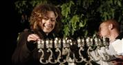 Tanya Rosenblit lights a Hanukkiyah at the demonstration against women's exclusion, at Bet Shemesh.27.12.11. Photograph by: Uri Lentz, Flash 90.