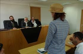 A women converting to Judaism in front of a three-judge Orthodox rabbinic court in Jerusalem. (Flash90)