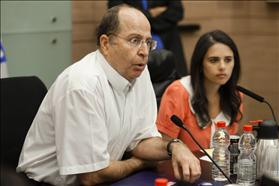 Defense Minister Moshe Ya'alon and Chair of the Committee to draft the Equality in Sharing the Burden Law MK Ayelet Shaked of Habayit Hayehudi in committee meeting. 9.15.2013. Photo: Flash90